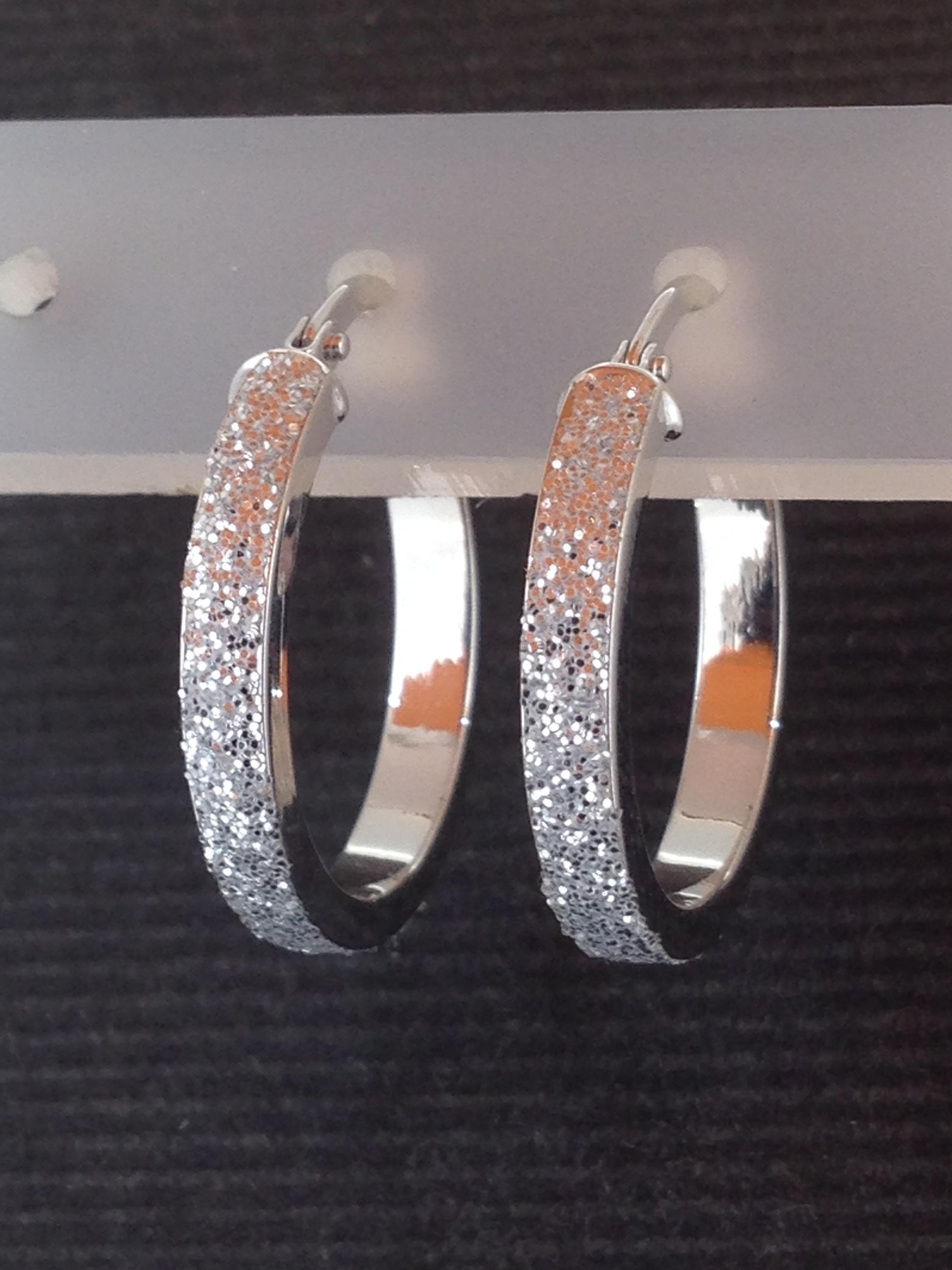 Boucles d'oreilles créole or blanc 18 carats
