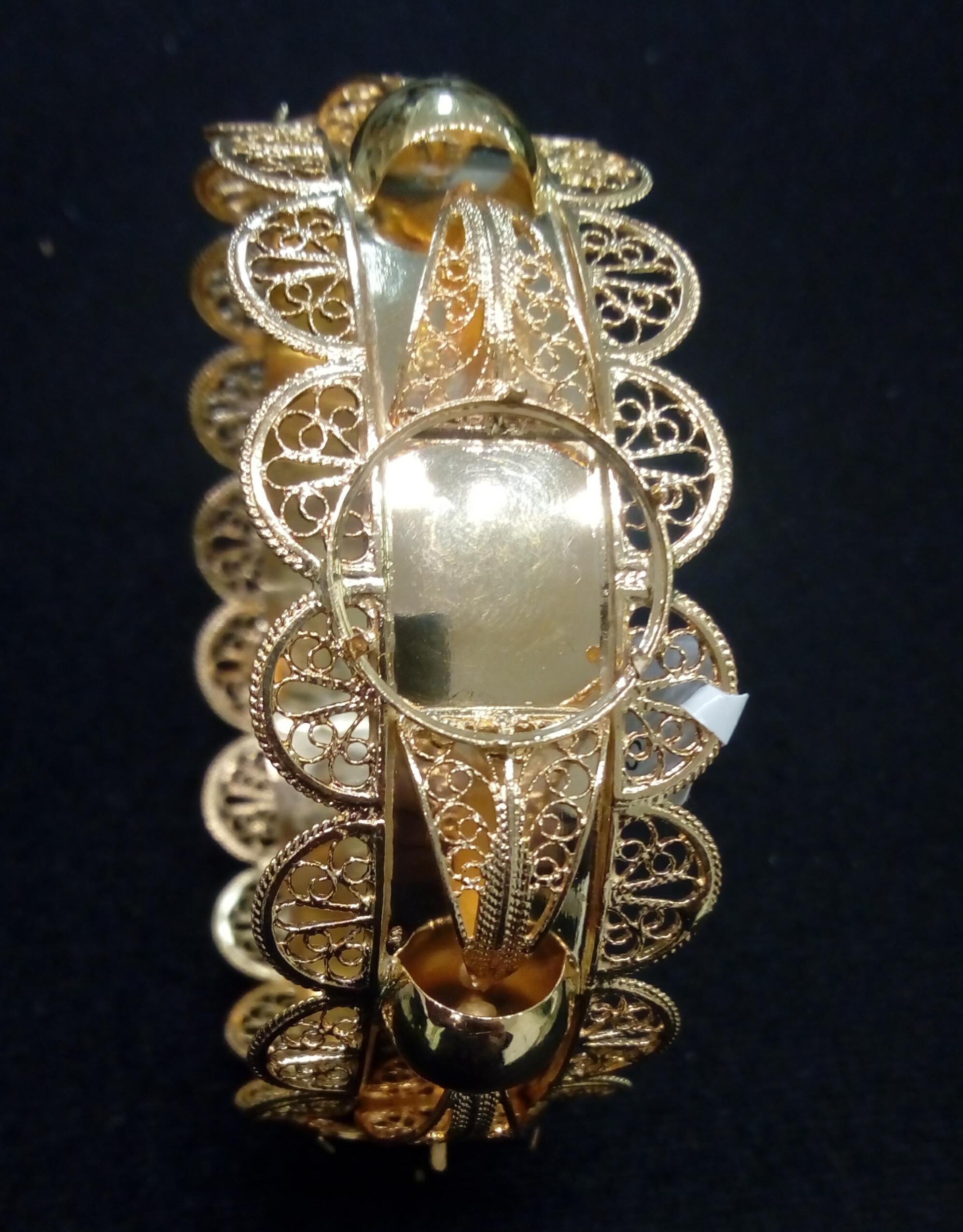 Bracelet or 18 carats porte piece 10 frs