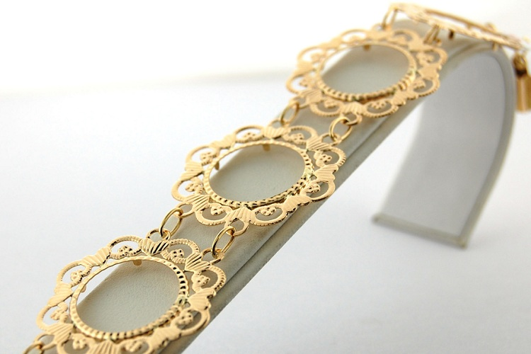 Bracelet or 18 carats porte pièce